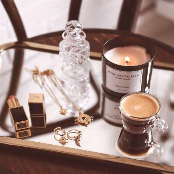 Lifestyle Flat Lay Gold Jewellery with Coffee. Coin Necklaces.