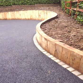 curved sleeper walls for drive entrance