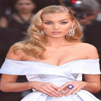Elsa Hosk wearing a High Jewellery diamond and tanzanite ring and diamond earrings by De Grisogono