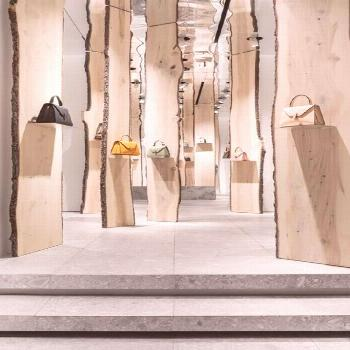 kengo kuma creates enchanted forest pop-up inside valextra's milan store