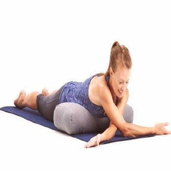 Lie on your stomach and place a bolster or a rolled towel under your lower ribs. Take your right ar
