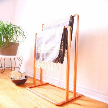 This versatile free-standing copper rack can be used to display towels, blankets, quilts, etc. The