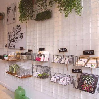 Use grid concept usually found in retail in a small space to maximize storage and organization. Bri