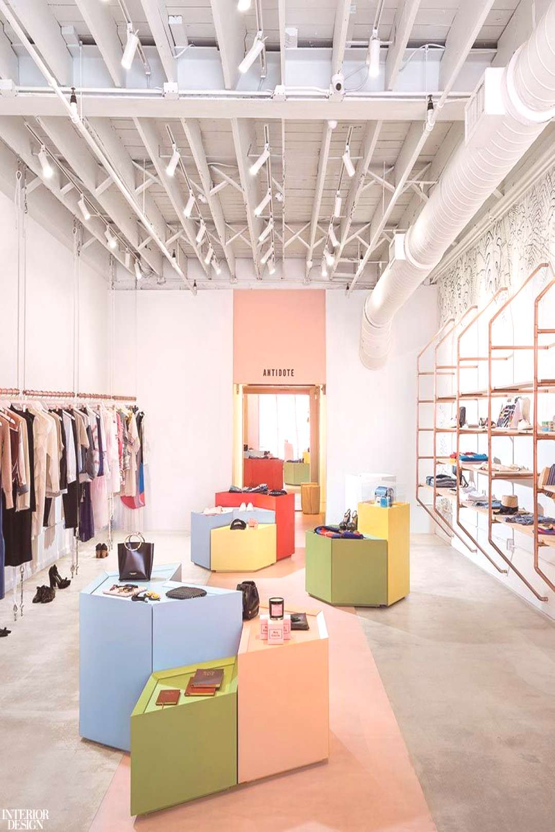 Antidote boutique by Atelier de Yavorsky. Lacquered MDF display cubes add a visual dynamic to the