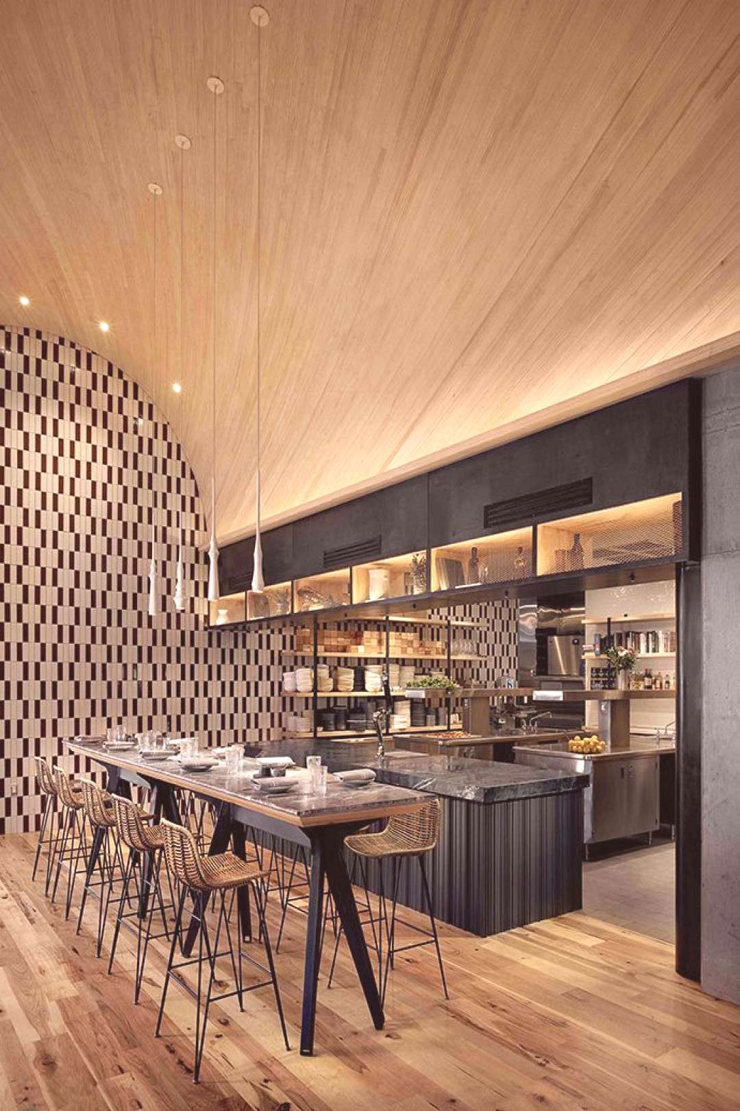 ATX Cocina, Austin, USA | vaulted ceiling of hemlock and pine arches elegantly over the open kitche