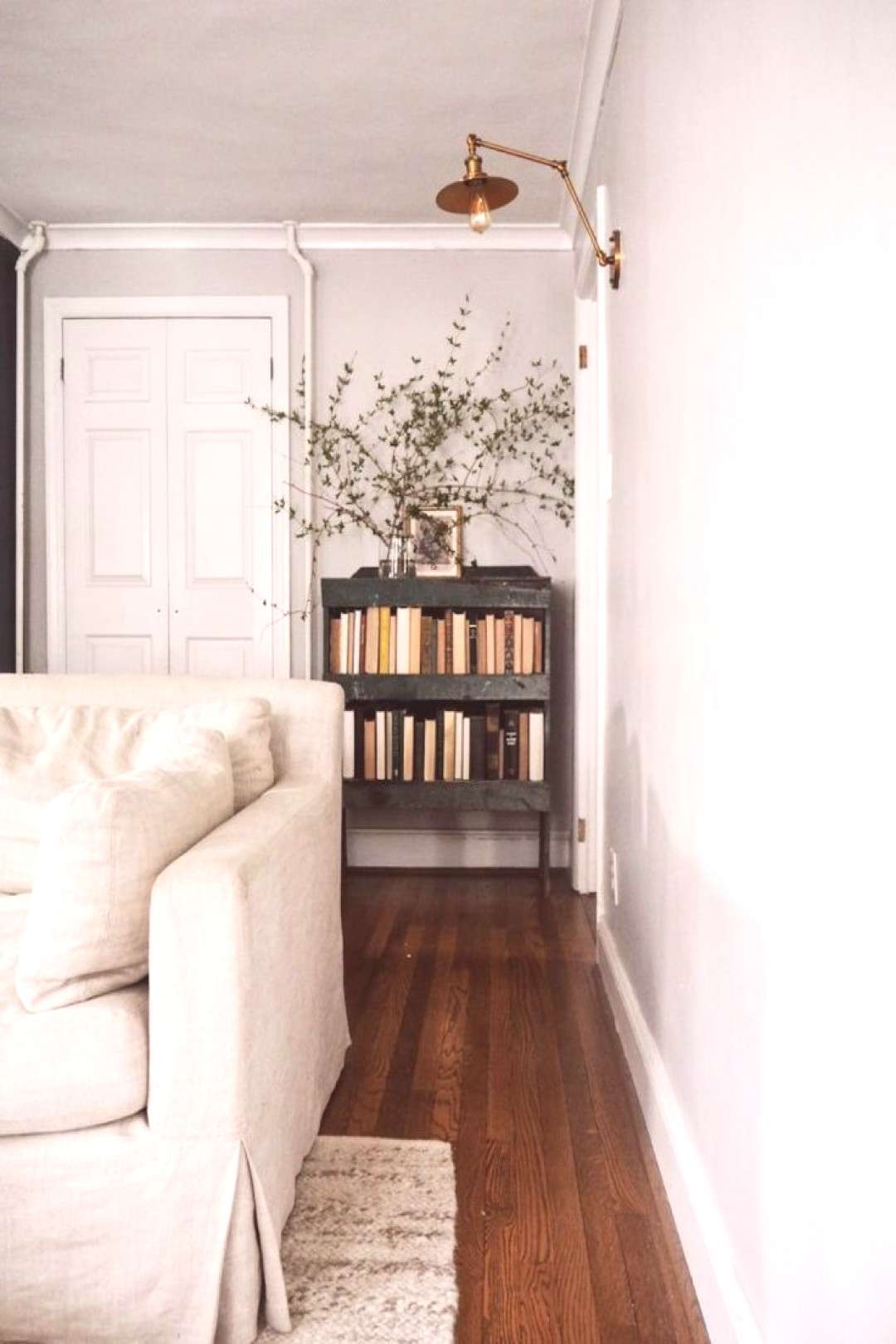 Love the restoration hardware couch and west elm rug, this is gorgeous and she got it all on a budg