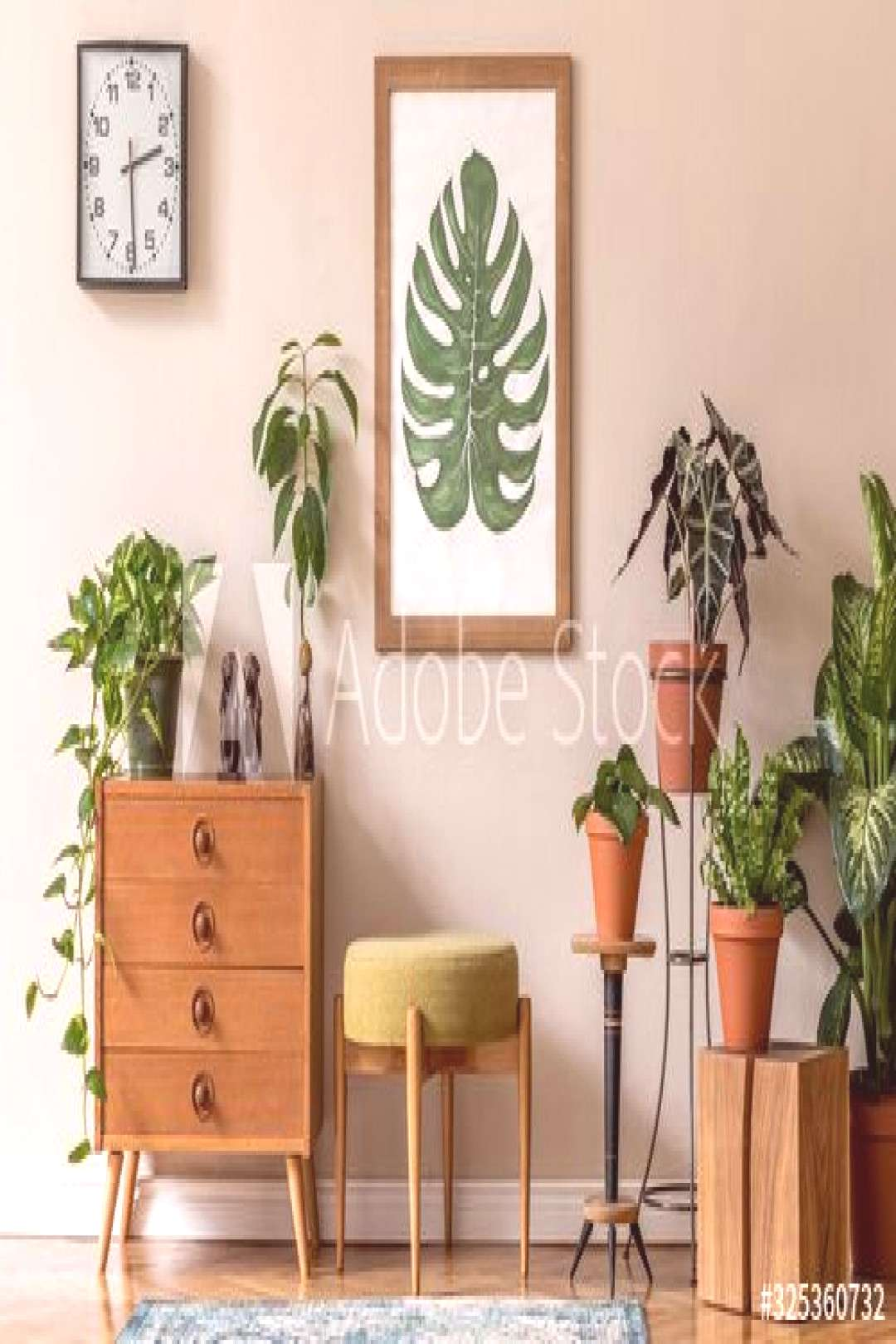 Vintage interior design of living room with stylish retro furnitures, a lot of plants, commode, bla