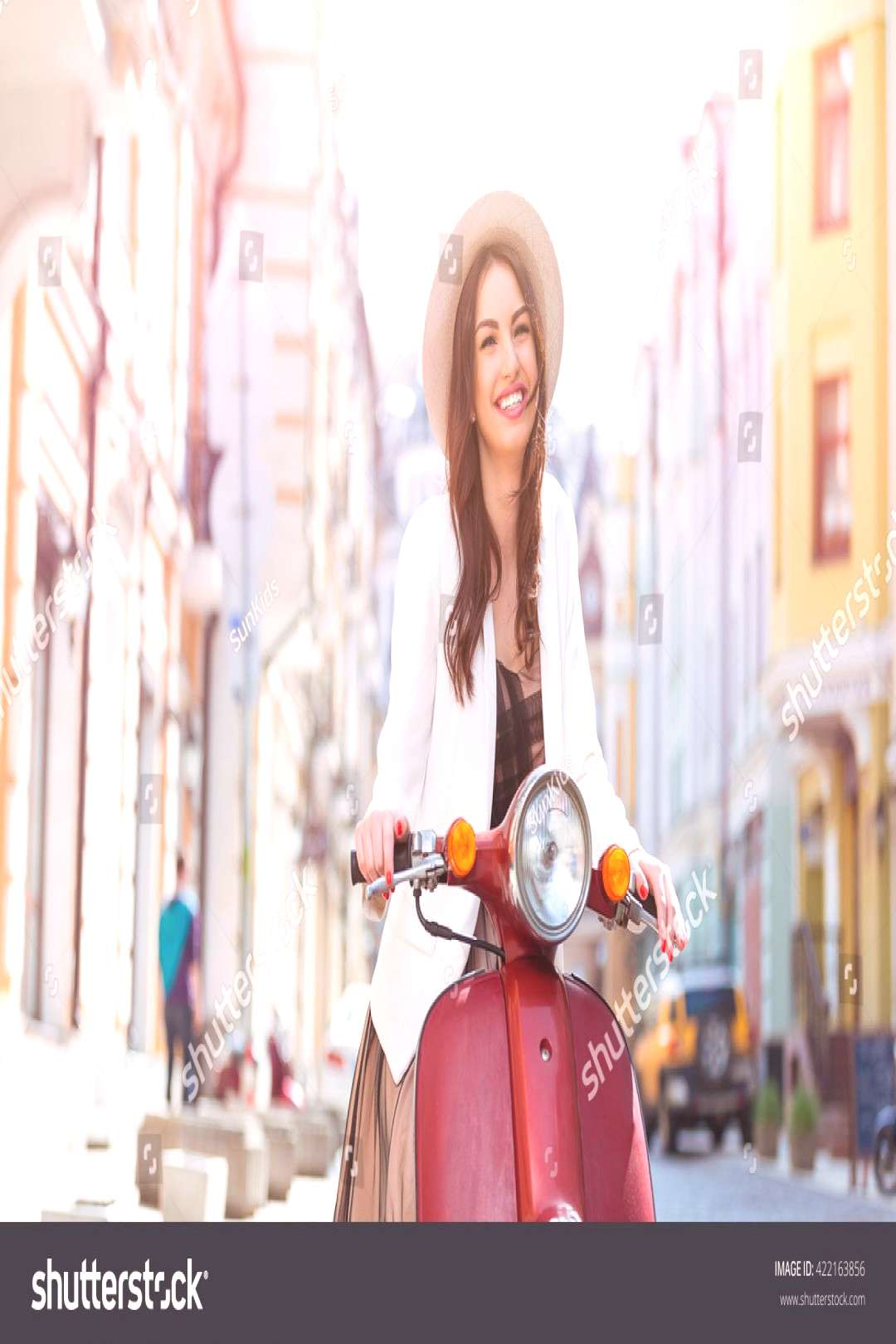 Woman in retro dress with a scooter over urban background ,